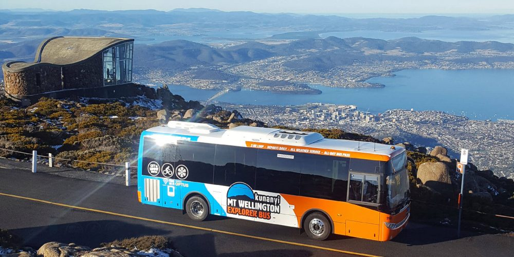 Mt Wellington bus at the summit of kunanyi/Mt Wellington. A sunny day with spectacular views over Hobart.